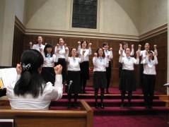The choir performs a beautiful Korean anthem.