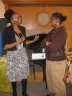 Tracy Freeman explains her project to fellow student, Cherri Murphy.