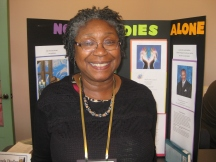 Brenda Dudley displays her project about ministering to people in their last days.