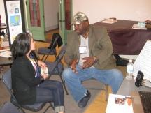 Cecil Richardson discusses his project with Adjunct Professor Corinna Guerrero.