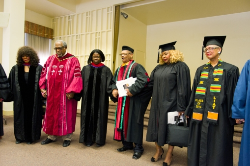 Rev. Dr. J. Alfred Smith, Sr leads the faculty, staff, trustees, and graduates in a prayer before the ceremony.
